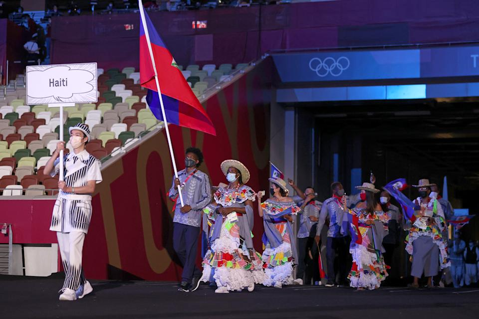 <p>TOKYO, JAPAN - JULY 23: Flag bearers Sabiana Anestor and Darrelle Valsaint Jr of Team Haiti during the Opening Ceremony of the Tokyo 2020 Olympic Games at Olympic Stadium on July 23, 2021 in Tokyo, Japan. (Photo by Jamie Squire/Getty Images)</p>