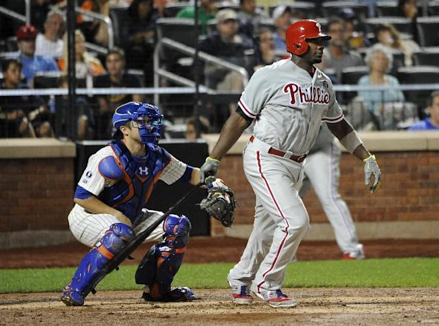 New York Mets catcher Travis d'Arnaud, left, and Philadelphia Phillies' Ryan Howard watch Howard's two-run single off of New York Mets starting pitcher Bartolo Colon in the sixth inning of a baseball game at Citi Field on Saturday, Aug. 30, 2014, in New York. (AP Photo/Kathy Kmonicek)