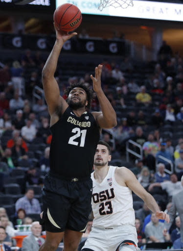 Colorado's Evan Battey (21) shoots over Oregon State's Gligorije Rakocevic during the first half of an NCAA college basketball game in the quarterfinal round of the Pac-12 men's tournament Thursday, March 14, 2019, in Las Vegas. (AP Photo/John Locher)