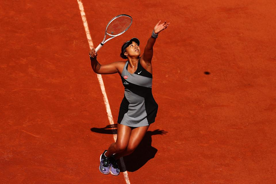 <p>Naomi Osaka serves in her first round match against Patricia Maria Tig at the French Open</p> (Getty Images)