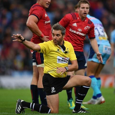 Today's referee Jérôme Garcès signals for a knock-on during a Champions Cup match - Credit: Getty images