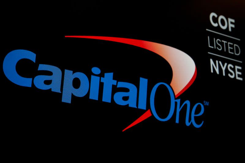 The logo and ticker for Capital One are displayed on a screen on the floor of the NYSE in New York