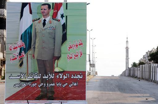 A billboard bearing President Bashar al-Assad's in Baba Amro neighbourhood in Homs, central Syria, on May 12, 2014