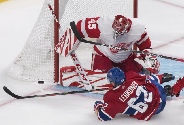 Montreal Canadiens' Artturi Lehkonen (62) slides in against Detroit Red Wings goaltender Jonathan Bernier (45) during third-period NHL hockey game action in Montreal, Thursday, Oct. 10, 2019. (Graham Hughes/The Canadian Press via AP)