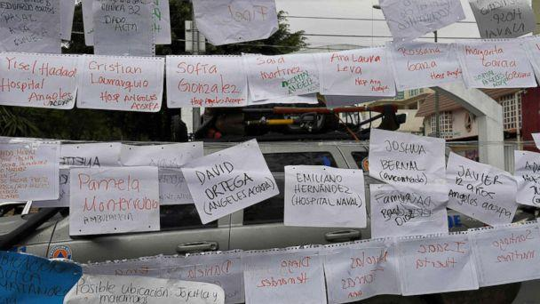 PHOTO: Sheets of paper display names and lists of people and the hospitals they are in, near a school where at least 21 children died and 30 are missing in Mexico City on Sept. 20, 2017. (Omar Torres/AFP/Getty Images)