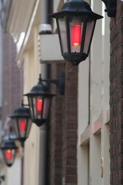 Lamps signal places that practice the oldest profession in the Red Light District in Amsterdam.