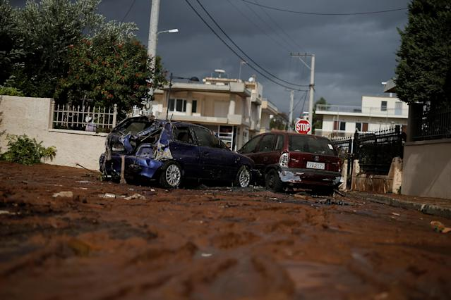 <p>Destroyed cars block a muddy road following a heavy rainfall in the town of Mandra, Greece, Nov. 15, 2017. (Photo: Alkis Konstantinidis/Reuters) </p>