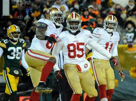 Jan 5, 2014; Green Bay, WI, USA; San Francisco 49ers tight end Vernon Davis (85) celebrates a touchdown with wide receiver Anquan Boldin (81) and wide receiver Quinton Patton (11) in the 4th quarter as Green Bay Packers cornerback Tramon Williams (38) looks on during the 2013 NFC wild card playoff football game at Lambeau Field. The 49ers beat the Packers 23-20. Mandatory Credit: Benny Sieu-USA TODAY Sports