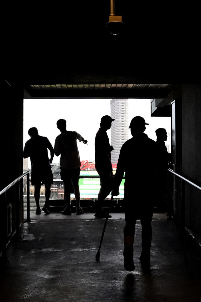 Fans leave during a rain delay in the ninth inning of a baseball game between the Arizona Diamondbacks and the Chicago Cubs in Chicago, Saturday, July 24, 2021. (AP Photo/Nam Y. Huh)