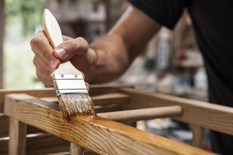 """It's not just drywall and plaster that need to be primed before painting—the same goes for unfinished wood surfaces. Without using a primer first, """"you can risk having moisture seep into the wood, which will later cause rot and damage,"""" explains Elron."""