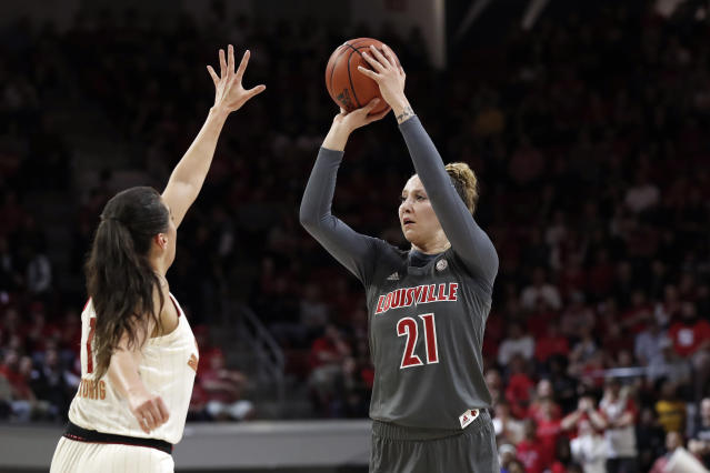 Louisville forward Kylee Shook (21) shoots while North Carolina State guard Aislinn Konig defends during the first half of an NCAA college basketball game in Raleigh, N.C., Thursday, Feb. 13, 2020. (AP Photo/Gerry Broome)