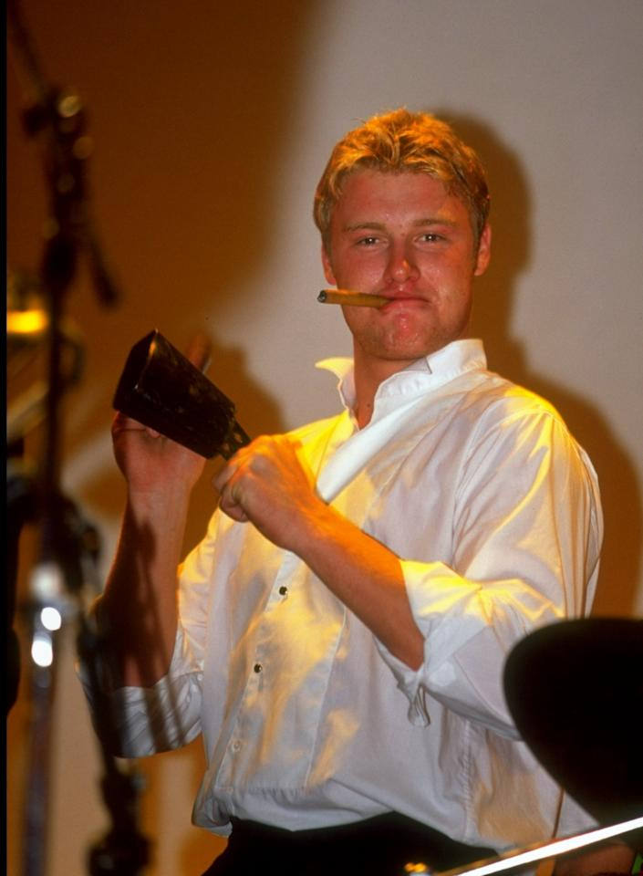 29 Sep 1999:  Andrew Flintoff of Lancashire and England helps with the band's percussion at the PCA Awards Dinner held at the Royal Albert Hall, London.  \ Mandatory Credit: Clive Mason /Allsport
