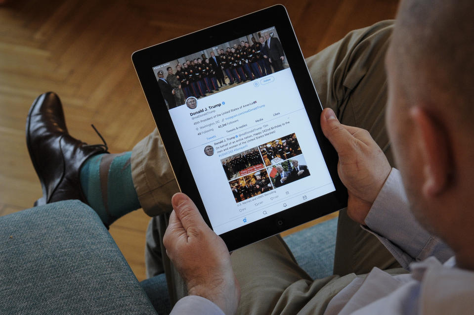 A man holds an iPad with Donald Trump's Twitter feed visible on November 10, 2017. (Photo by Jaap Arriens/NurPhoto via Getty Images)