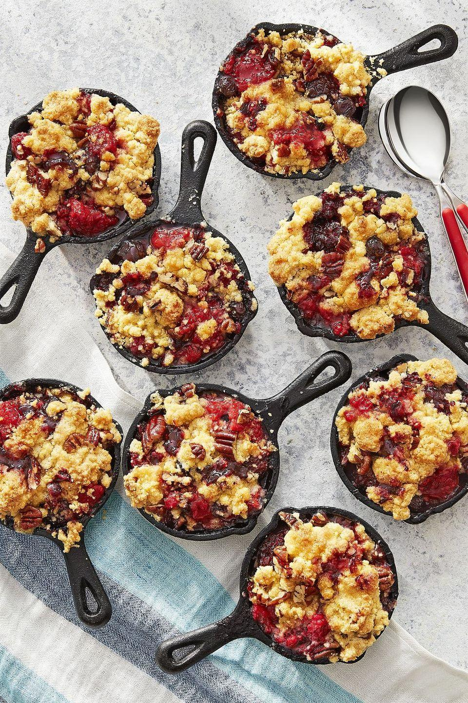 """<p>Everyone will love digging into personal-sized cobblers bursting with fresh berries and topped with chopped pecans.</p><p><strong><a href=""""https://www.countryliving.com/food-drinks/recipes/a43072/jiffy-mixed-berry-cornmeal-cobbler-recipe/"""" rel=""""nofollow noopener"""" target=""""_blank"""" data-ylk=""""slk:Get the recipe"""" class=""""link rapid-noclick-resp"""">Get the recipe</a>.</strong> </p>"""