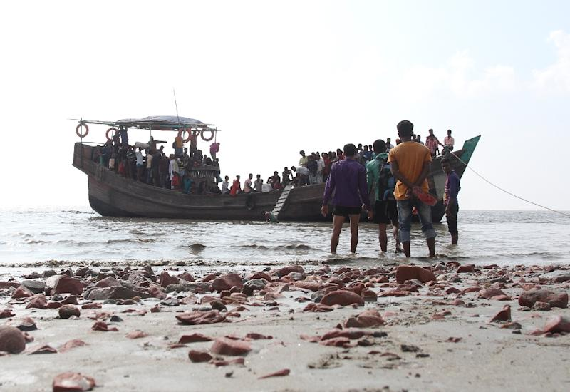 Thousands of Rohingya refugees from Myanmar attempt to reach Malaysia and Thailand in pursuit of a better life -- often in rickety, unseaworthy vessels, as seen in this photo from 2018