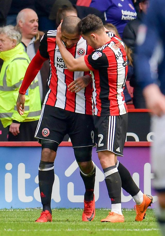 "Soccer Football - Championship - Sheffield United vs Millwall - Bramall Lane, Sheffield, Britain - April 14, 2018 Sheffield United's Leon Clarke celebrates with George Baldock after scoring their first goal Action Images/Paul Burrows EDITORIAL USE ONLY. No use with unauthorized audio, video, data, fixture lists, club/league logos or ""live"" services. Online in-match use limited to 75 images, no video emulation. No use in betting, games or single club/league/player publications. Please contact your account representative for further details."