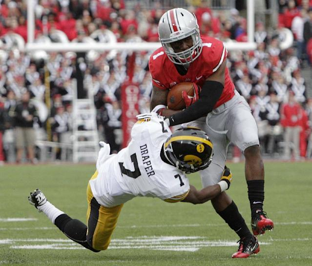 Ohio State running back Donte Wilson, right, is tackled by Iowa defensive back Sean Draper during the first quarter of an NCAA college football game Saturday, Oct. 19, 2013, in Columbus, Ohio. (AP Photo/Jay LaPrete)