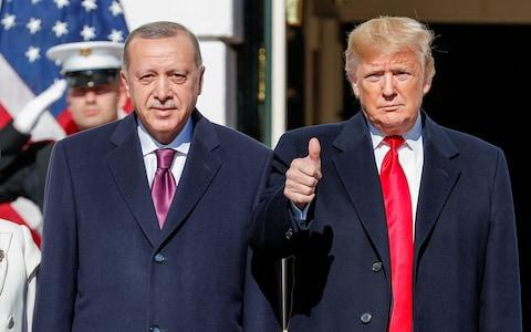 Donald Trump welcomes Turkey's President Erdogan at the White House in Washington - Credit: Reuters