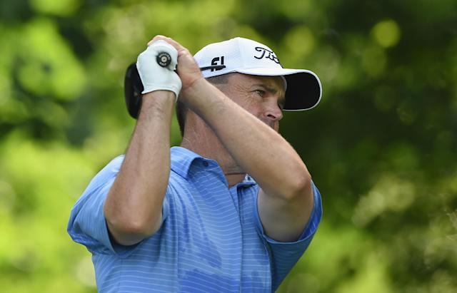 Greg Chalmers of Australia watches his tee shot on the 14th hole during a first round of the Quicken Loans National at Congressional Country Club on June 26, 2014 in Bethesda, Maryland (AFP Photo/Patrick Smith)