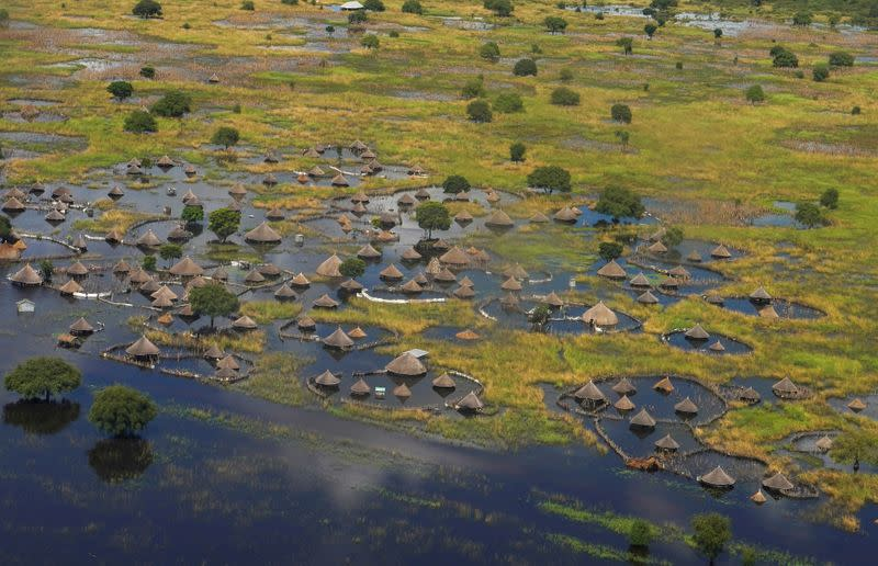 FILE PHOTO: FILE PHOTO: An aerial view shows flooded homes within a village after the River Nile broke the dykes in Jonglei State