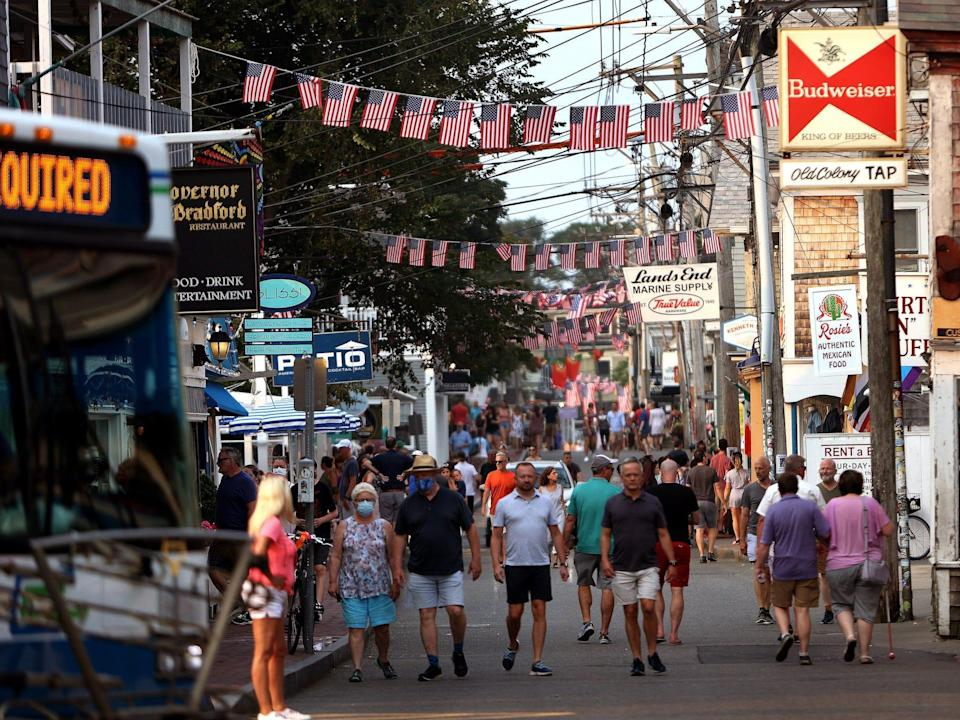 commercial street in provincetown draped with flags