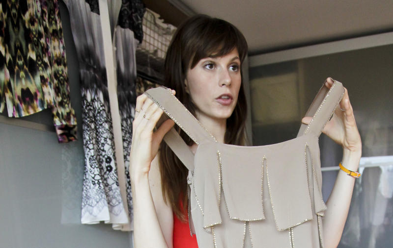 This Aug. 15, 2012 photo shows model Elettra Wiedemann showing off fashion from her closet at her apartment in New York. Wiedemann, daughter of Isabella Rossellini, landed on this year's Vanity Fair's International Best-Dressed dressed list. She's now keeping company with the Duchess of Cambridge, Diane Kruger and Jay-Z. (AP Photo/Bebeto Matthews)