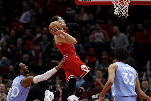 Chicago Bulls guard Zach LaVine, center, goes up for a dunk past Minnesota Timberwolves guard Josh Okogie during the first half of an NBA basketball game in Chicago, Wednesday, Jan. 22, 2020. (AP Photo/Nam Y. Huh)