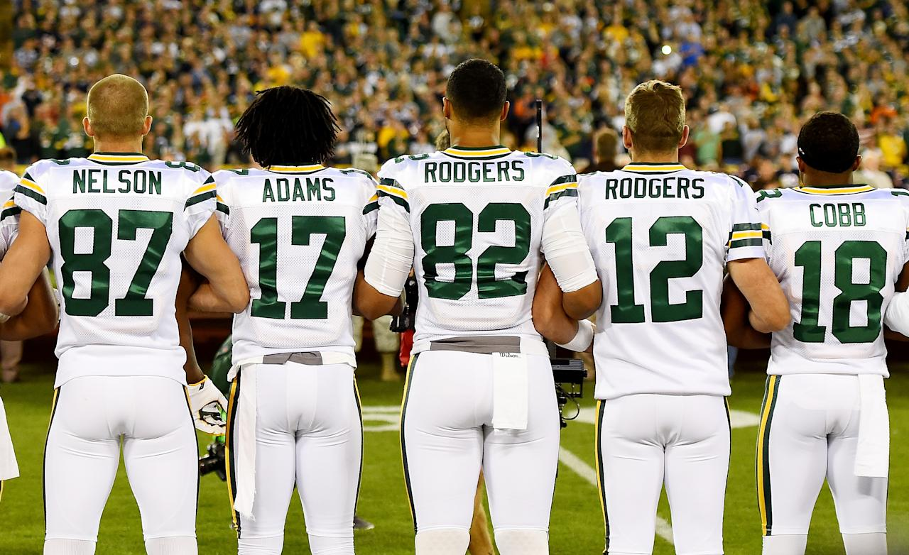 <p>Green Bay Packers players link arms during the singing of the national anthem before the game against the Chicago Bears at Lambeau Field on September 28, 2017 in Green Bay, Wisconsin. (Photo by Stacy Revere/Getty Images) </p>