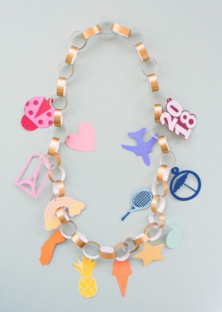"<p>Give your graduate something extra fun to wear at their graduation party with this lei inspired by a charm bracelet. You can include their graduating year and cut-outs representing their hobbies and things they love. </p><p><strong>Get the tutorial at <a href=""http://thehousethatlarsbuilt.com/2018/03/charm-bracelet-graduation-lei.html/"" rel=""nofollow noopener"" target=""_blank"" data-ylk=""slk:The House That Lars Built"" class=""link rapid-noclick-resp"">The House That Lars Built</a>.</strong></p><p><a class=""link rapid-noclick-resp"" href=""https://go.redirectingat.com?id=74968X1596630&url=https%3A%2F%2Fwww.walmart.com%2Fip%2FFoil-Cardstock-24-Pack-Gold-Metallic-Mirror-Board-Sheets-Arts-Crafts-8-5-x-11-Inches-350gsm-Letter-Sized-Poster-Board-Scrapbook-Paper-DIY-Card-Invita%2F691196660&sref=https%3A%2F%2Fwww.thepioneerwoman.com%2Fhome-lifestyle%2Fentertaining%2Fg36014713%2Fgraduation-party-ideas%2F"" rel=""nofollow noopener"" target=""_blank"" data-ylk=""slk:SHOP GOLD PAPER"">SHOP GOLD PAPER</a></p>"