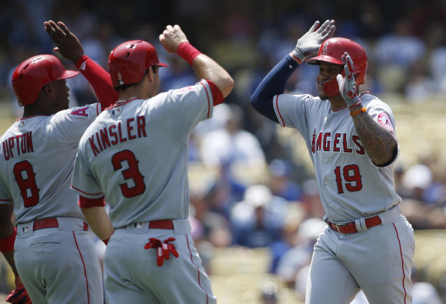 Los Angeles Angels' Jefry Marte, right, celebrates after hitting a three-run home run to drive in Justin Upton , left, and Ian Kinsler, center, during the fourth inning of a baseball game Sunday, July 15, 2018, in Los Angeles. (AP Photo/Danny Moloshok)