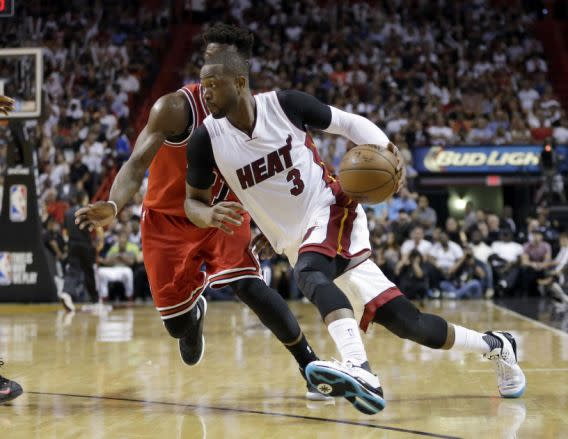 "<a class=""link rapid-noclick-resp"" href=""/nba/players/3708/"" data-ylk=""slk:Dwyane Wade"">Dwyane Wade</a> drives into his new future. (AP Photo/Alan Diaz, File)"
