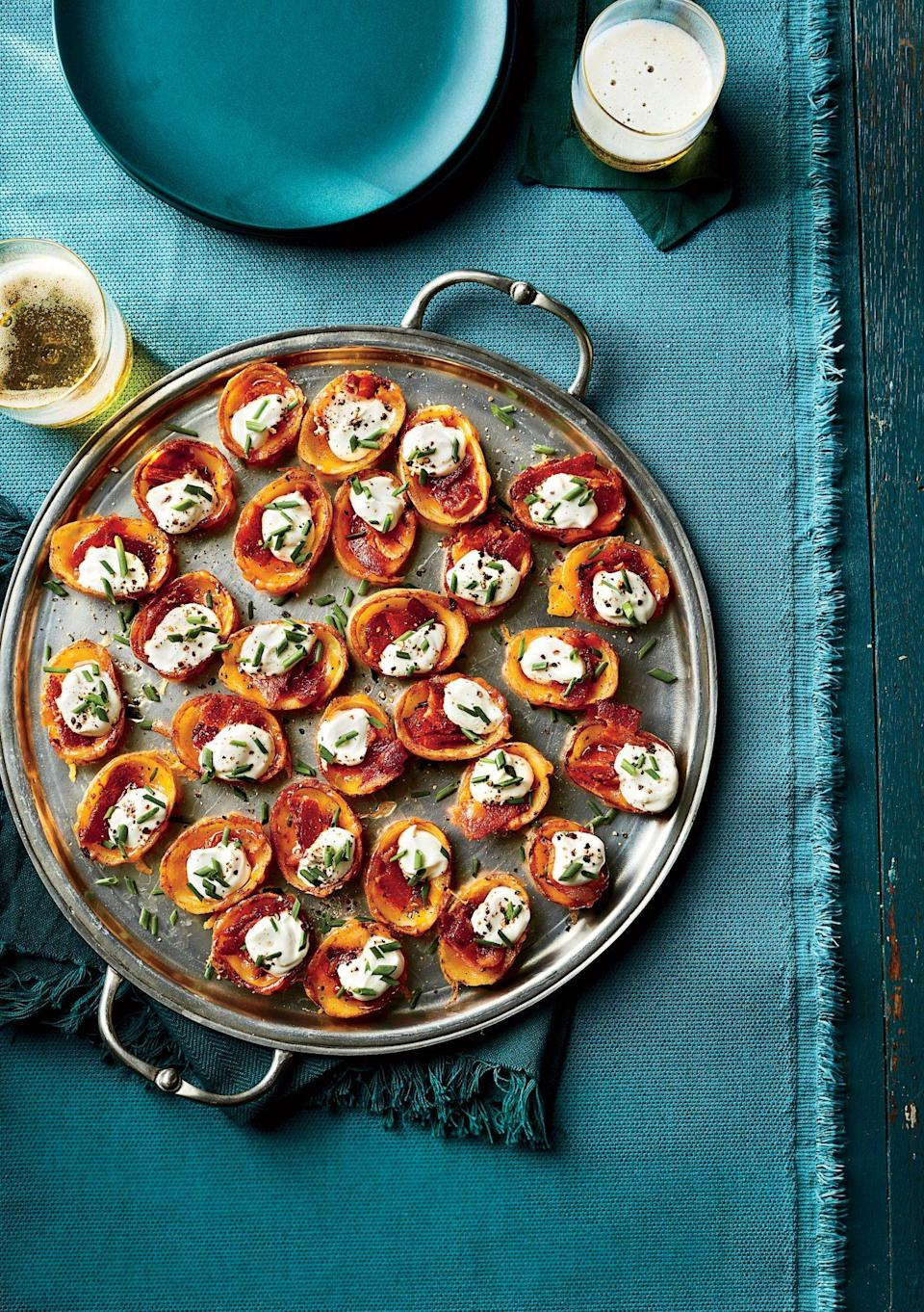 """<p><strong>Recipe: <a href=""""https://www.southernliving.com/recipes/mini-potato-skins-recipe"""" rel=""""nofollow noopener"""" target=""""_blank"""" data-ylk=""""slk:Mini Potato Skins"""" class=""""link rapid-noclick-resp"""">Mini Potato Skins</a></strong></p> <p>Just five ingredients are needed to create this miniature version of the classic party food.</p>"""