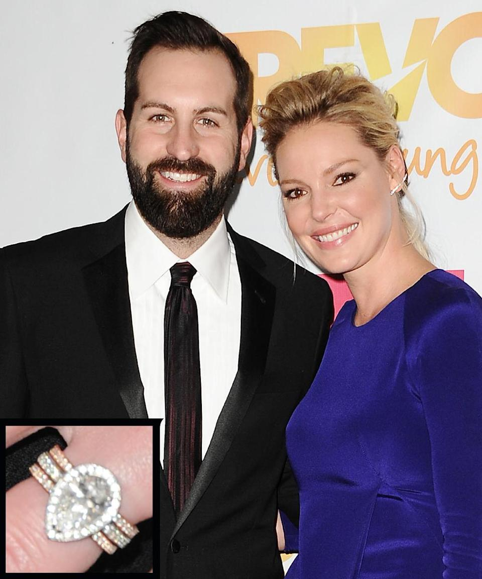 <p>Josh Kelley proposed to actress Katherine Heigl with a three-carat pear-cut diamond ring with an antique feel and look. The platinum band was created using half of the metal from Heigl's mother's engagement ring. The couple wed in December 2007.</p>