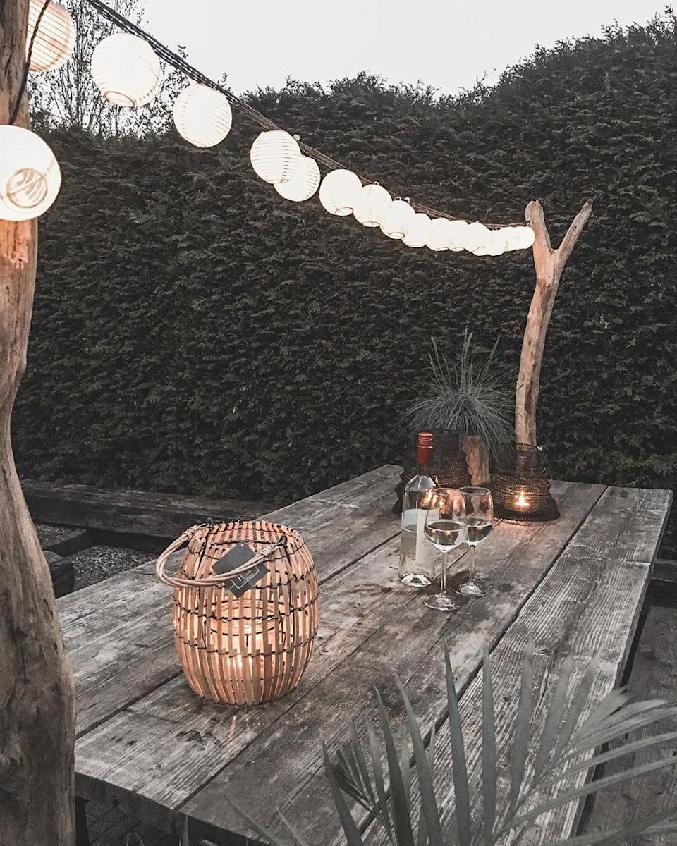 """<p>For a more natural vibe, opt for paper ball lights over classic class bulbs. These remind us of beachy nights in the Hamptons and Malibu.</p><p><strong>See more at <a href=""""https://www.instagram.com/beau_wonen/"""" rel=""""nofollow noopener"""" target=""""_blank"""" data-ylk=""""slk:beau_wonen"""" class=""""link rapid-noclick-resp"""">beau_wonen</a>.</strong></p><p><a class=""""link rapid-noclick-resp"""" href=""""https://www.amazon.com/Lantern-String-Lights-Outdoor-Bedroom/dp/B083RT1KCB/?tag=syn-yahoo-20&ascsubtag=%5Bartid%7C10050.g.31137877%5Bsrc%7Cyahoo-us"""" rel=""""nofollow noopener"""" target=""""_blank"""" data-ylk=""""slk:SHOP PAPER STRING LIGHTS"""">SHOP PAPER STRING LIGHTS</a></p>"""