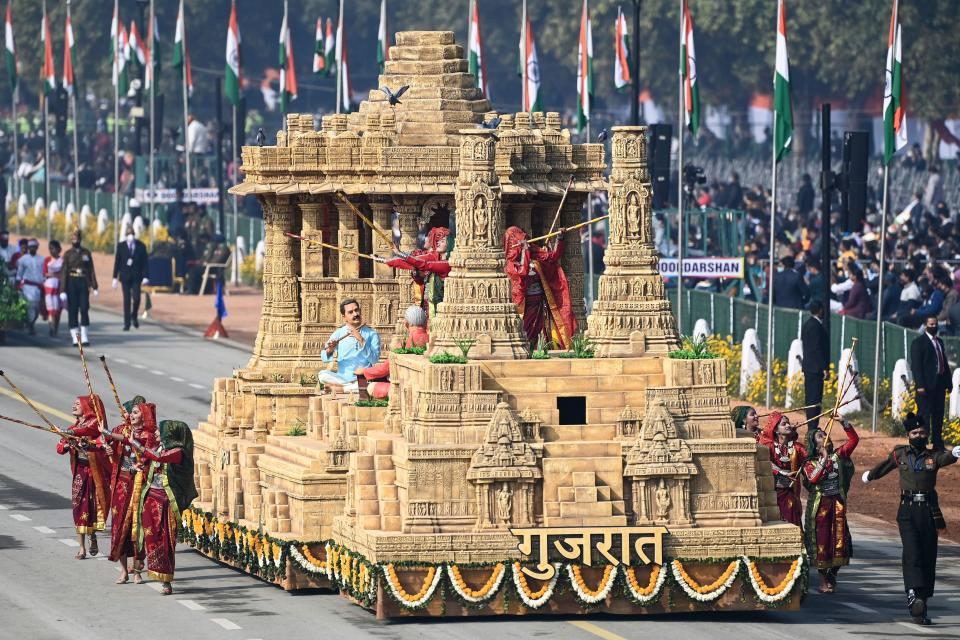 Performers dance next to a float representing Gujarat on Rajpath during the Republic Day parade in New Delhi on January 26, 2021. (Photo by Jewel SAMAD / AFP) (Photo by JEWEL SAMAD/AFP via Getty Images)