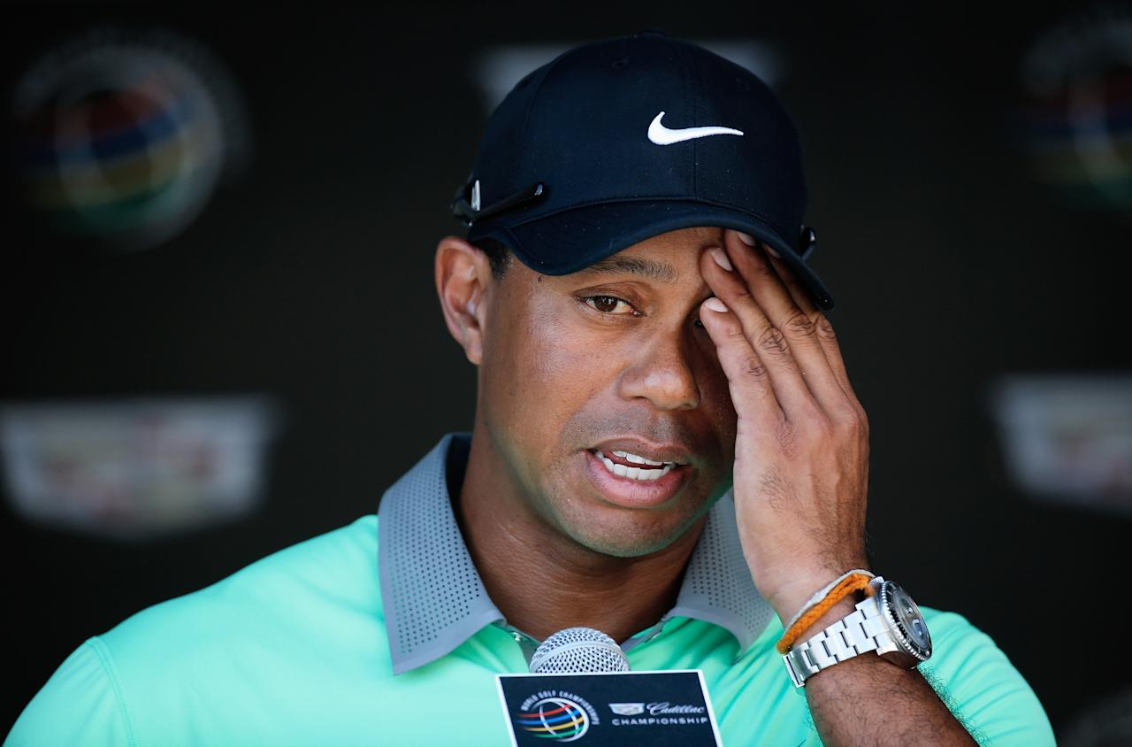 DORAL, FL - MARCH 08: Tiger Woods speaks with the media after a six-under par 66 during the third round of the World Golf Championships-Cadillac Championship at Trump National Doral on March 8, 2014 in Doral, Florida. (Photo by Chris Trotman/Getty Images)