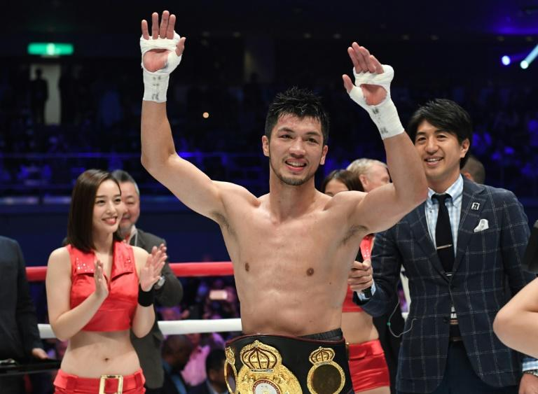Ryota Murata of Japan  raises his arms after his victory by technical knockout against Hassan N'Dam of France