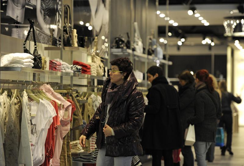 Shoppers browse clothes in a store in London