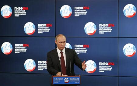 """Russia's President Vladimir Putin delivers a speech at the """"Oil and gas companies as an engine driving change in the world economy"""" session at the St. Petersburg International Economic Forum 2014 (SPIEF 2014) in St. Petersburg May 24, 2014. REUTERS/Sergei Karpukhin"""