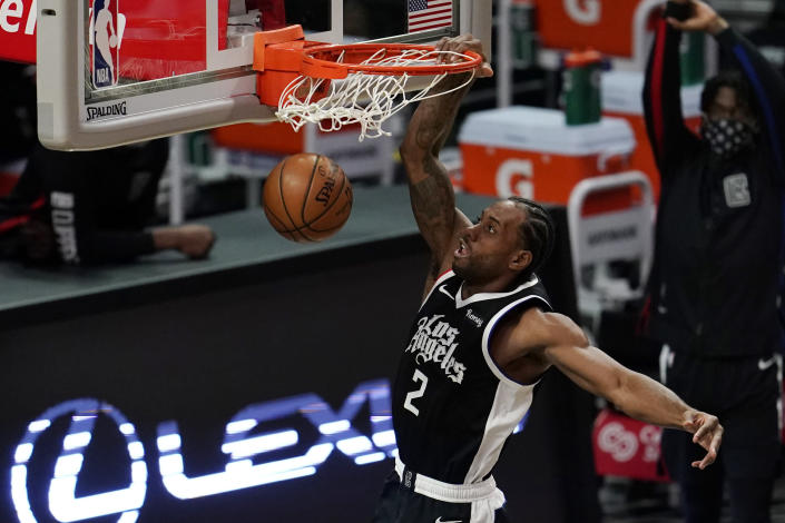 Los Angeles Clippers forward Kawhi Leonard (2) dunks against the Chicago Bulls during the second half of an NBA basketball game Sunday, Jan. 10, 2021, in Los Angeles. (AP Photo/Marcio Jose Sanchez)