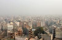 A residential area is seen shrouded in smog in New Delhi