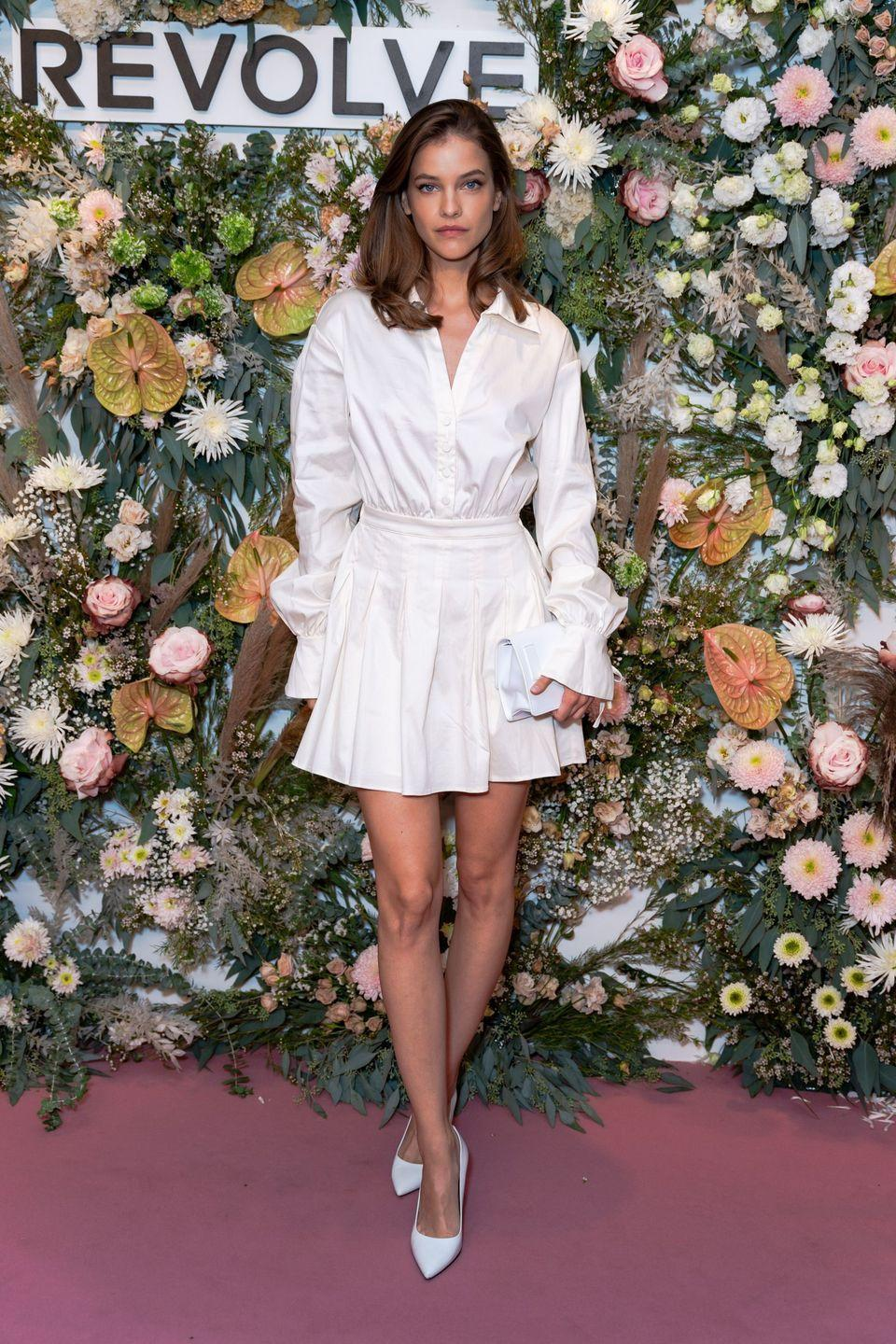 <p><strong>9 September</strong></p><p>Barbara Palvin looked chic at the Revolve event in a white shirt and matching pleated skirt.</p>