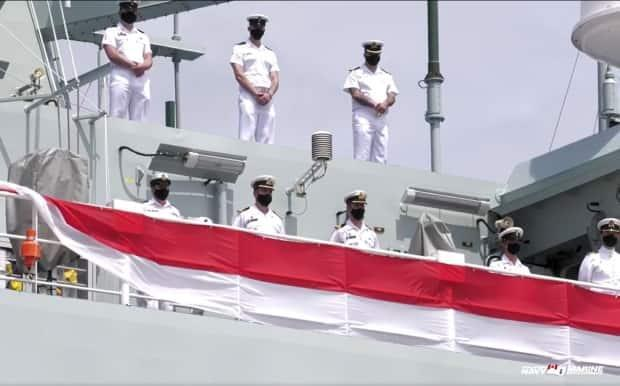 Naval officers are shown observing the commissioning ceremony from the deck of HMCS Harry DeWolfe. (Royal Canadian Navy - image credit)