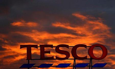 FILE PHOTO - A company logo is pictured outside a Tesco  supermarket in Altrincham northern England.