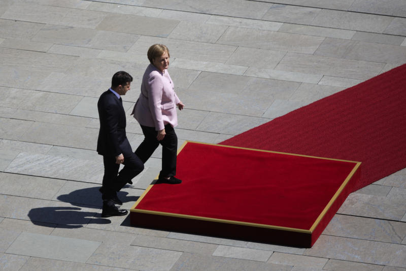 German Chancellor Angela Merkel, right, welcomes Ukrainian President Volodymyr Zelenskiy, left, for a meeting at the chancellery in Berlin, Germany, Tuesday, June 18, 2019. (AP Photo/Markus Schreiber)