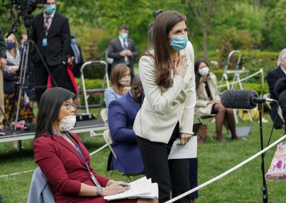 Weijia Jiang, left, of CBS and Kaitlan Collins of CNN ask questions of Donald Trump during a news conference in the Rose Garden of the White House. Following the exchange the president abruptly ended the briefing and walked away (REUTERS)
