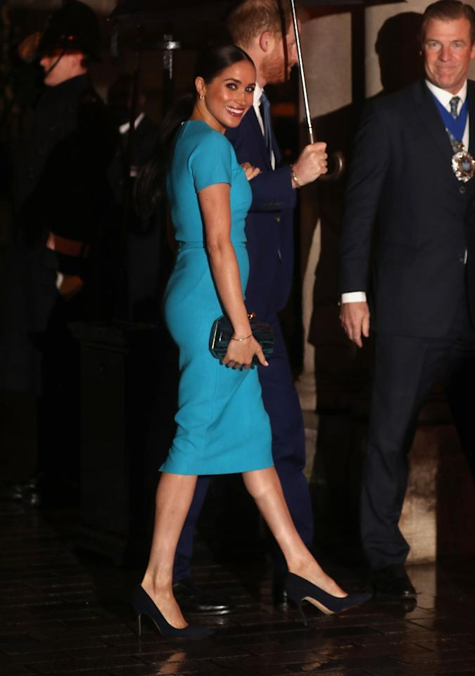 "<p>The <a href=""https://www.townandcountrymag.com/society/tradition/a31247693/meghan-markle-blue-dress-smile-endeavour-fund-awards-photos/"" target=""_blank"">chic look</a> was by British designer, Victoria Beckham. </p>"