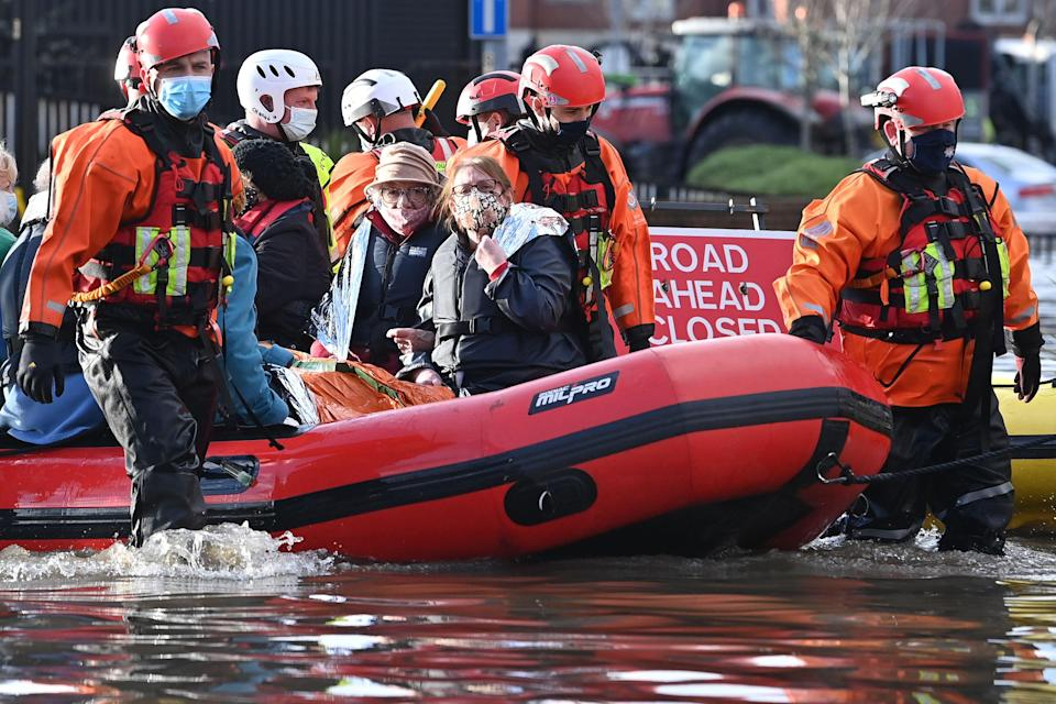 <p>Emergency services evacuate care home residents after they became stranded by flood water, in Northwich</p> (AFP via Getty Images)