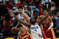 Atlanta Hawks forward John Collins (20), front, and Philadelphia 76ers center Joel Embiid (21) vie for the ball as teammates look on during the second half of Game 3 of a second-round NBA basketball playoff series, Friday, June 11, 2021, in Atlanta. (AP Photo/John Bazemore)