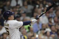 Milwaukee Brewers' Tyrone Taylor watches his grand slam during the seventh inning of the team's baseball game against the Chicago White Sox on Friday, July 23, 2021, in Milwaukee. (AP Photo/Aaron Gash)